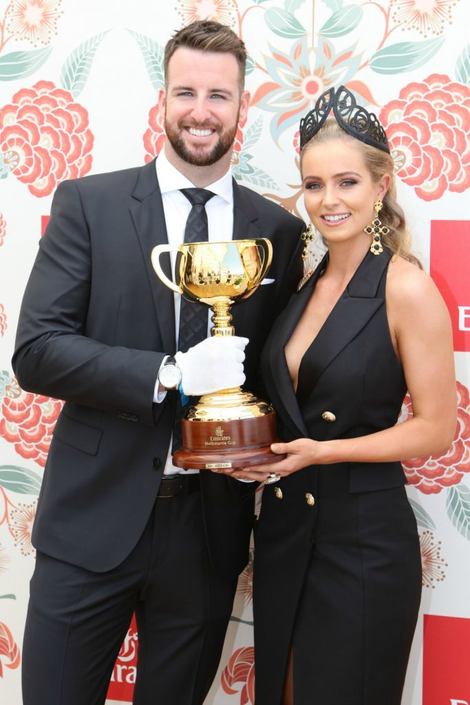 MELBOURNE, AUSTRALIA - OCTOBER 29: James Magnussen and Rose McEvoy poses with the Melbourne Cup at the Emirates marquee during Melbourne Cup Carnival for Derby day on October 29, 2016 in Melbourne, Australia. theraces.com.au