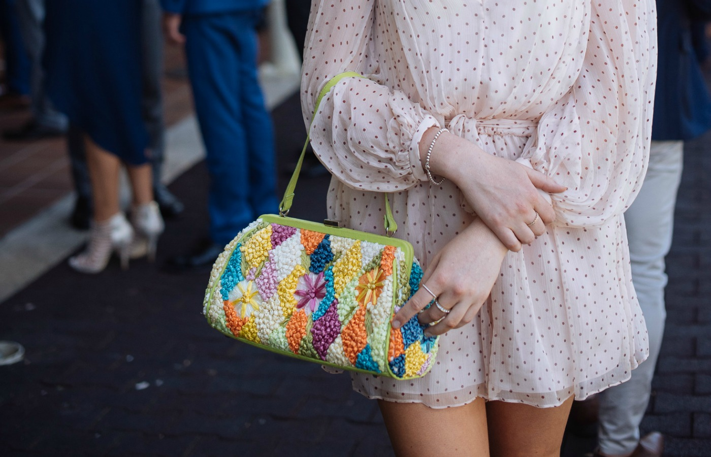 Colourful clutch bag street style fashion at Royal Randwick racecourse.