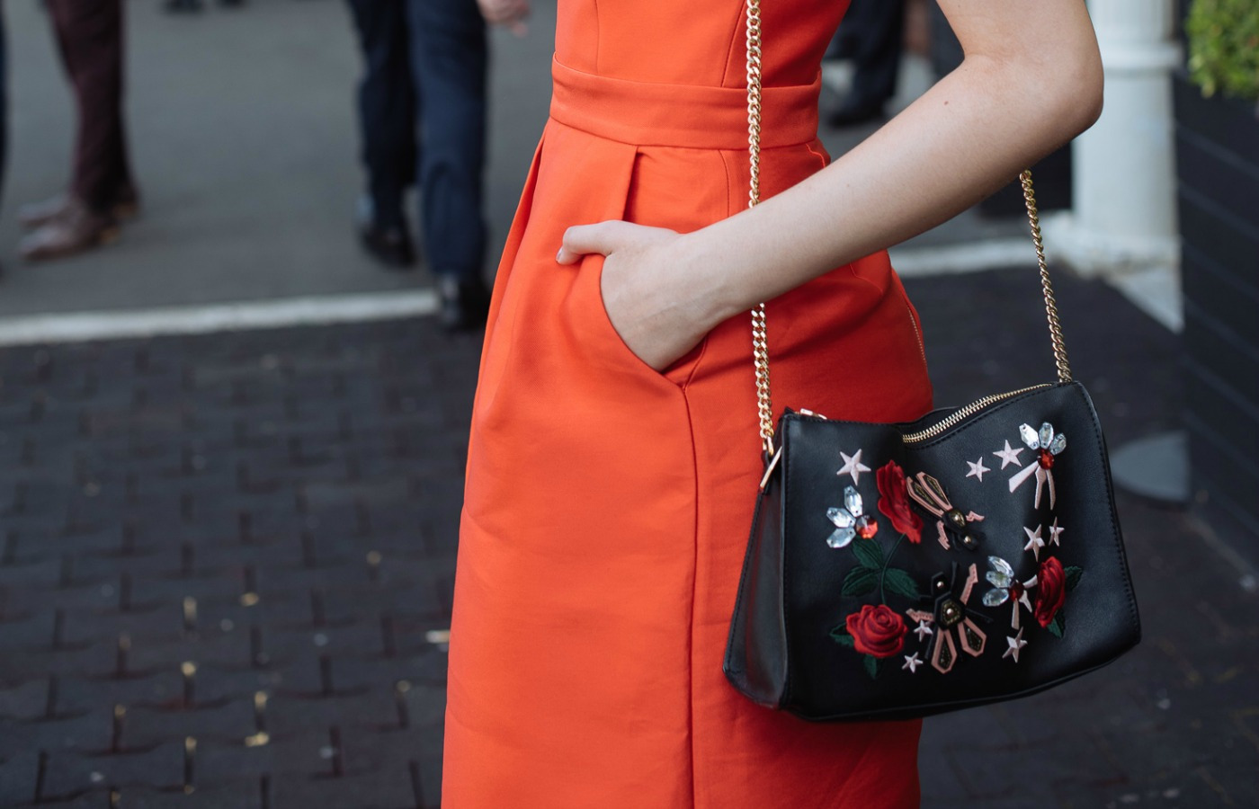 clutch bag streetstyle fashion at royal randwick racecourse.