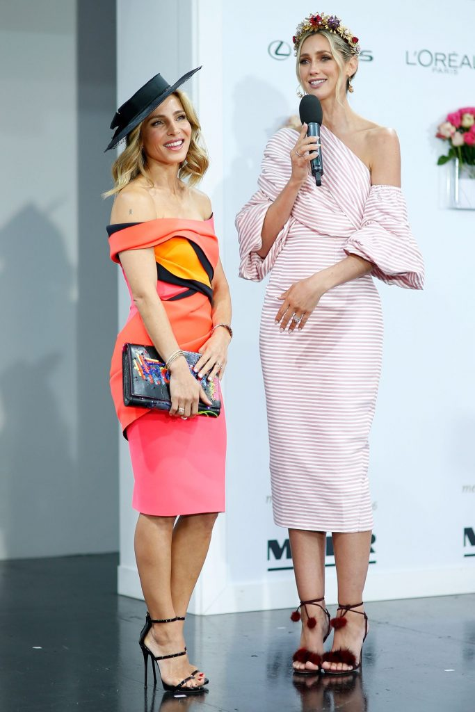Elsa Pataky and Nikki Phillips speak at the Myer Fashions on the Field on Emirates Melbourne Cup Day at Flemington Racecourse on November 1, 2016 in Melbourne, Australia.