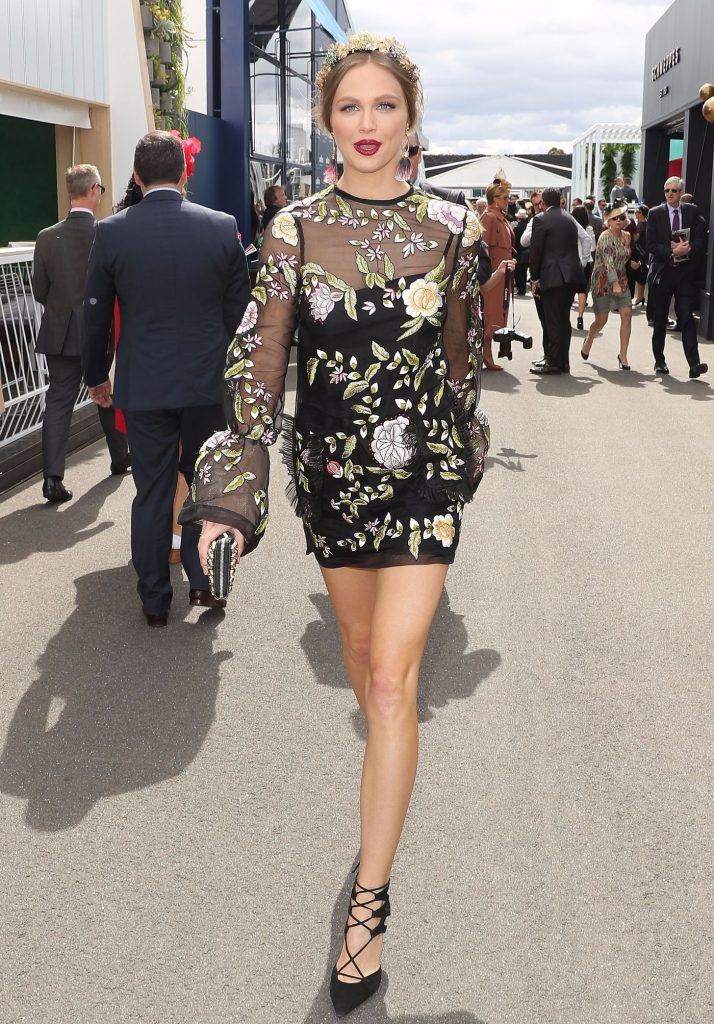 : Ksenija Lukich arrives on Melbourne Cup Day at Flemington Racecourse on November 1, 2016 in Melbourne, Australia.