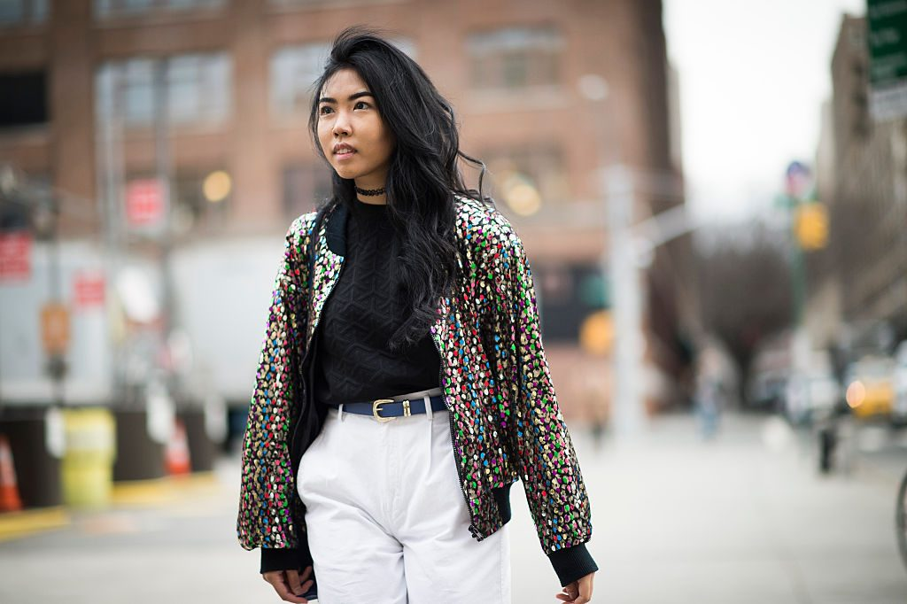 NEW YORK, NY - FEBRUARY 04: Sharina Chindavong is wearing glitter jacket and a blue bag in the streets of Manhattan during New York Fashion Week: Men's Fall/Winter 2016 on February 4, 2016 in New York City. (Photo by Timur Emek/Getty Images)
